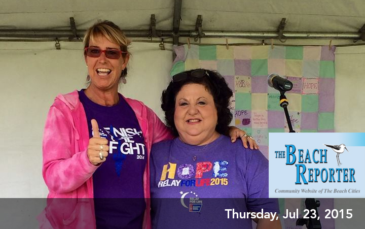 2x Cancer Survivor ACS Voice/ Hero of Hope Adrienne Slaughter gives a Thumbs Up to celebrating life with Event Chair Maria Stieritz at the Beach Cities Relay for Life on July 18, 2015.