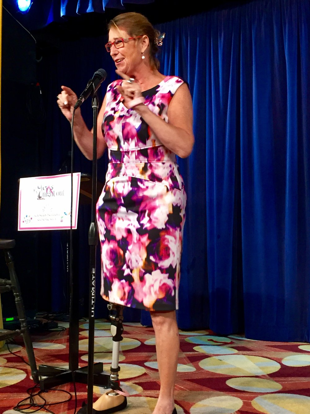 Inspiring at the Cancer Support Community's Girls Night Out for the 3rd time, Adrienne shares her smiles onstage to a sold-out crowd on 10/6/16 at the Comedy & Magic Club in Hermosa Beach, CA.