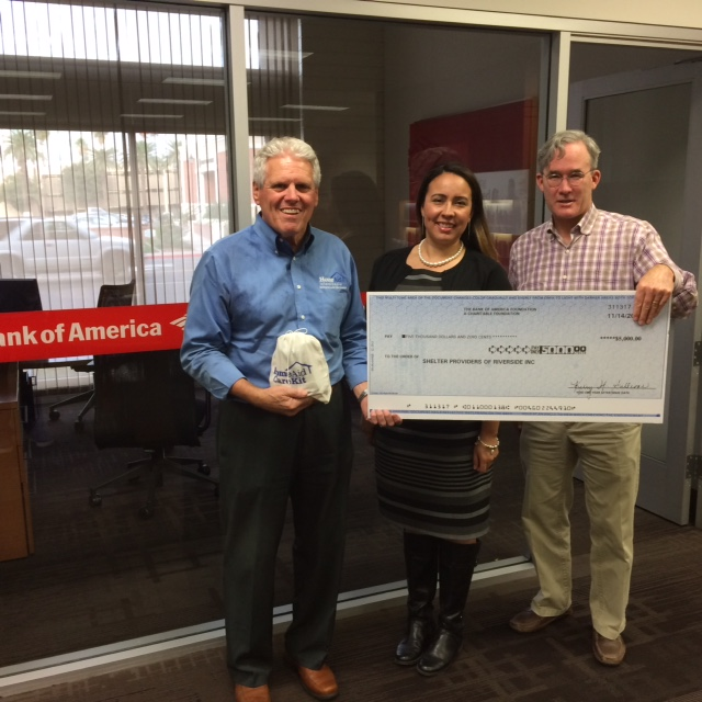 Bank of America Regional CSR manager Cathy Paredes, center, recently presented a Bank of America Charitable Foundation grant check for $5,000 to HomeAid Inland Empire Board President Richard Hedrick, right, and HAIE Executive Director Ray Osborne, left, to help support HomeAid's homeless shelter development and community outreach programs.