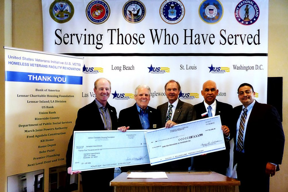 HomeAid Inland Empire (HAIE) recently provided $40,000 in funds to start phase two renovation work at the U.S. VETS homeless veterans facility at March ARB in Riverside. The funding was obtained through grants from the Lennar Charitable Housing Foundation and the Bank of America Foundation, as well as a donation from the Riverside County BIA. Chapter.Shown here with replica grant and donation checks at a recent U.S. VETS fundraiser event hosted by the Riverside City Firefighters Foundation are: (left to right) Ray Osborne, HomeAid Inland Empire Executive Director; Riverside City Fire Battalion Chief Thomas Jay, Riverside County Sheriff Stan Sniff; Eddie Estrada, U.S. VETS Inland Empire Region Executive Director; Stephen Peck, U.S.VETS CEO; and Satti Brown of KB Home and Co-Chair of the HAIE Executive Committee.