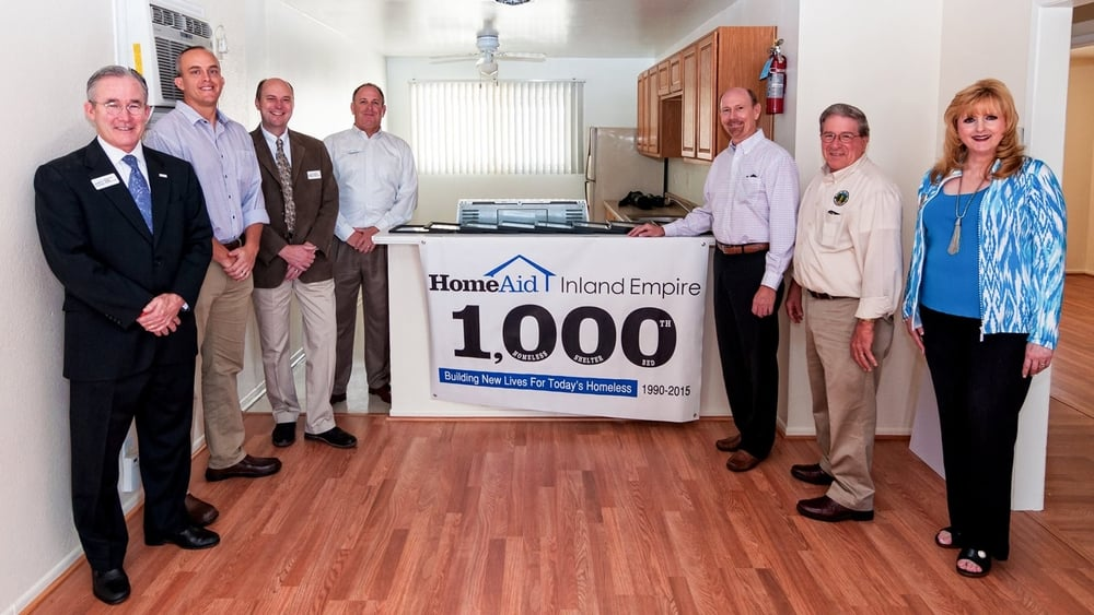 Several city officials were among the dignitaries who attended the recent dedication event a Foothill Family Shelter apartment in Upland to recognize the 1,000th homeless shelter bed developed by HomeAid Inland Empire. Pictured from right are Upland Councilmember Carol Timm, Mayor Ray Musser and Mayor Pro Tem Glenn Bozar. Also shown from left are 2016 HAIE Executive Committee members Richard Hedrick of imortgage, Landon Boucher of Boucher Resources, Tom Howell of Holt Architecture, and Todd Bourguignon of Lennar Homes.
