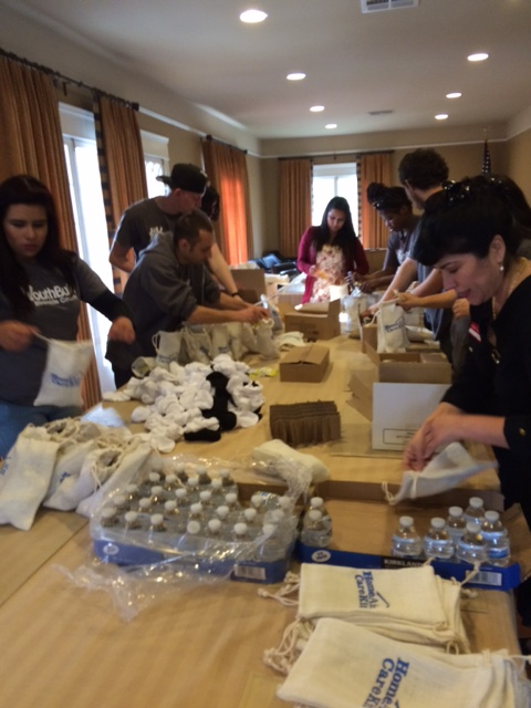 Students involved with the RCOE/CFLC YouthBuild program recently worked with HomeAid Inland Empire (HAIE) Executive Committee members and staff to assemble more than 150 HAIE Care Kits to be distributed to homeless individuals and families as part of a new Youth Build mentoring program.