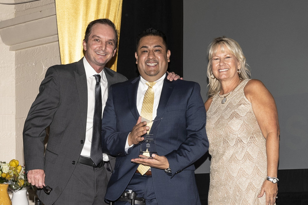 Jeff Clemens-Lennar and Donna Wetzel-First American NHD presents Associate of the Year Award to Eric Linares-Trane.