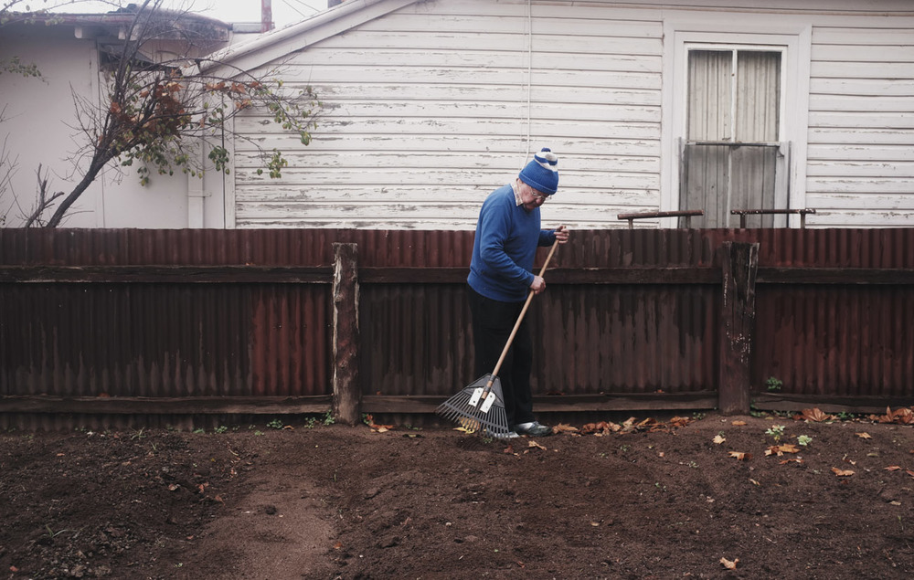 old man raking leave grandpa beanie