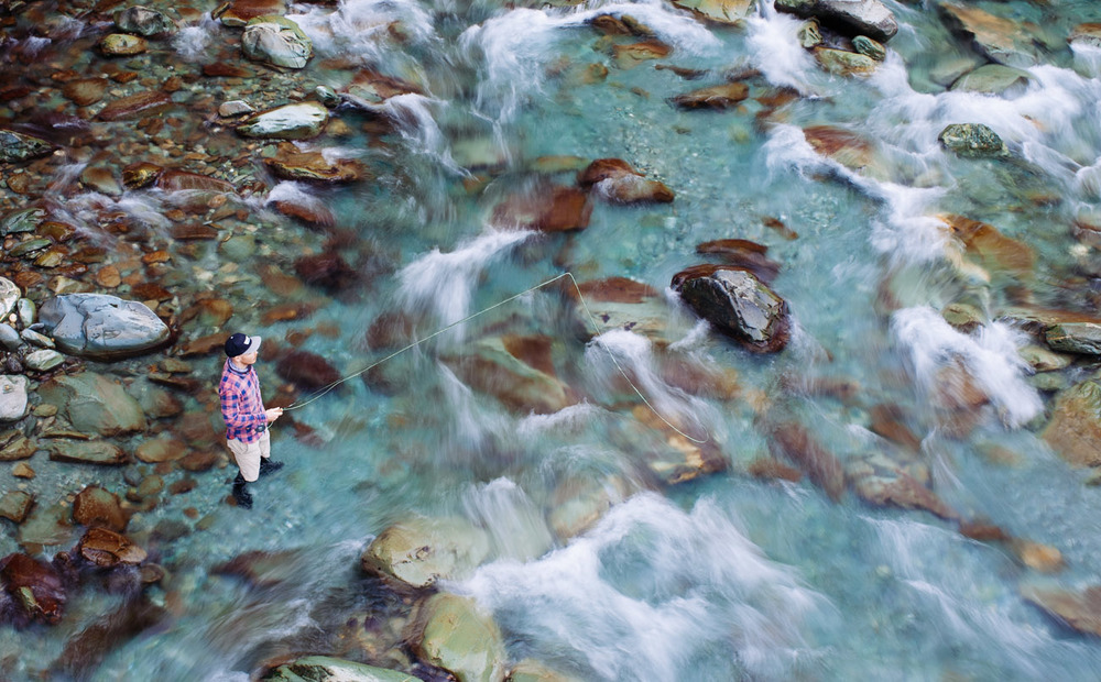 Fly fish fishing clear waters aerial  New Zealand