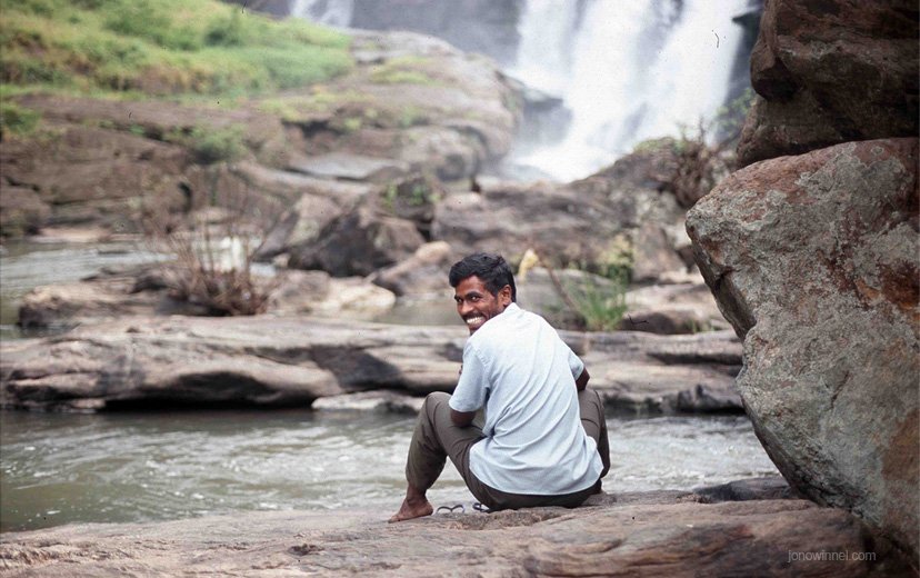 indian man smile happy portrait waterfall