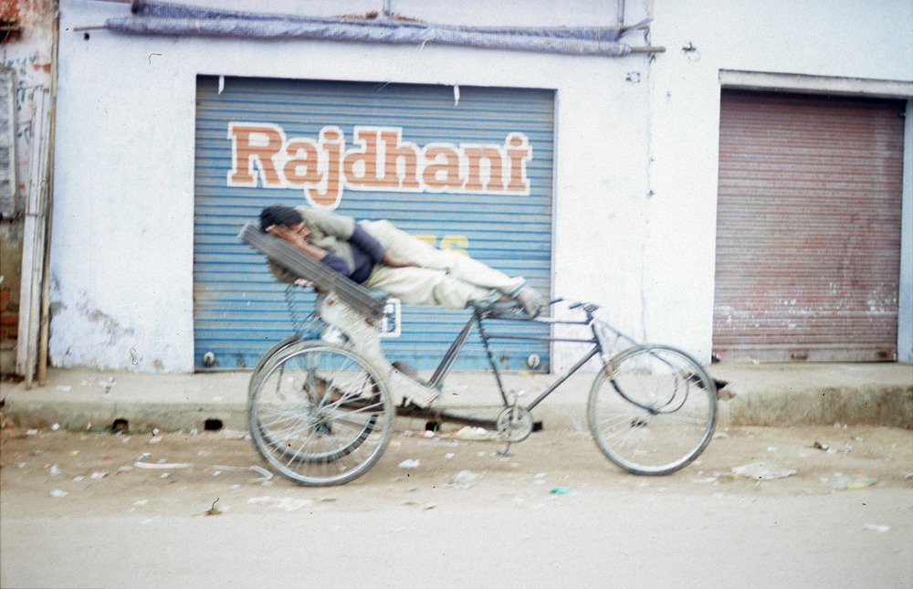 man sleeps work rajdhant tricycle taxi bicycle