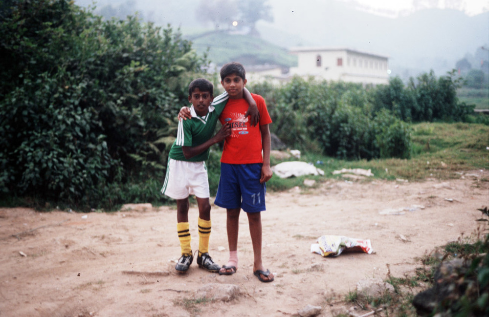 two boys friends india soccer hug