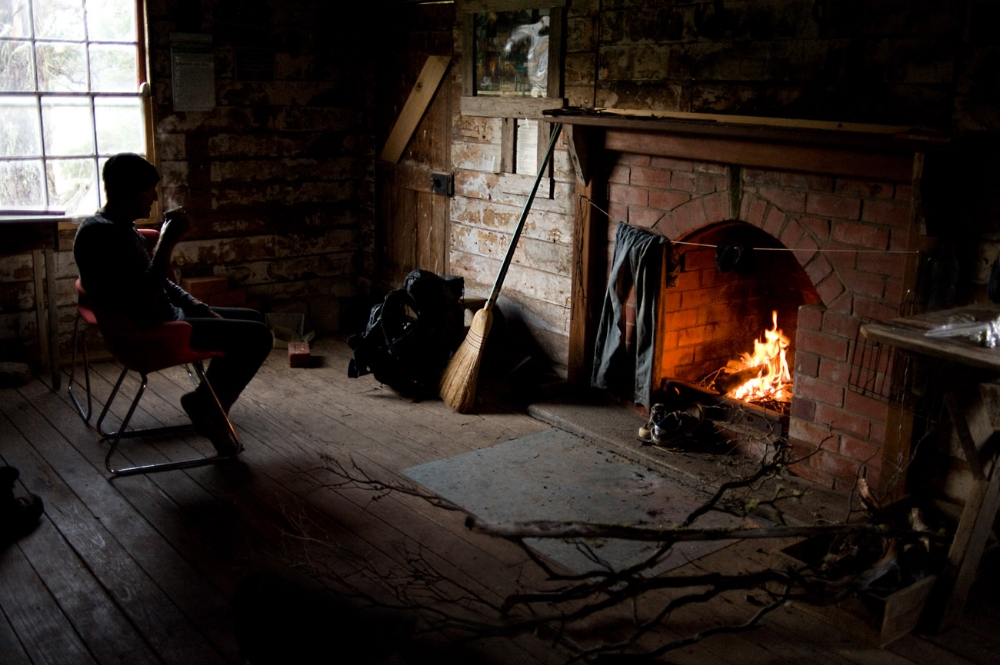 Resting fire rustic cabin hut hot drink