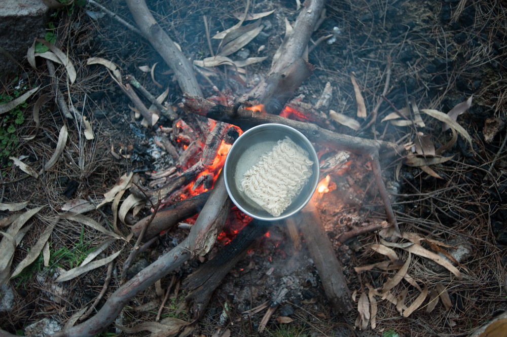 Cooking raman noodles on campfire