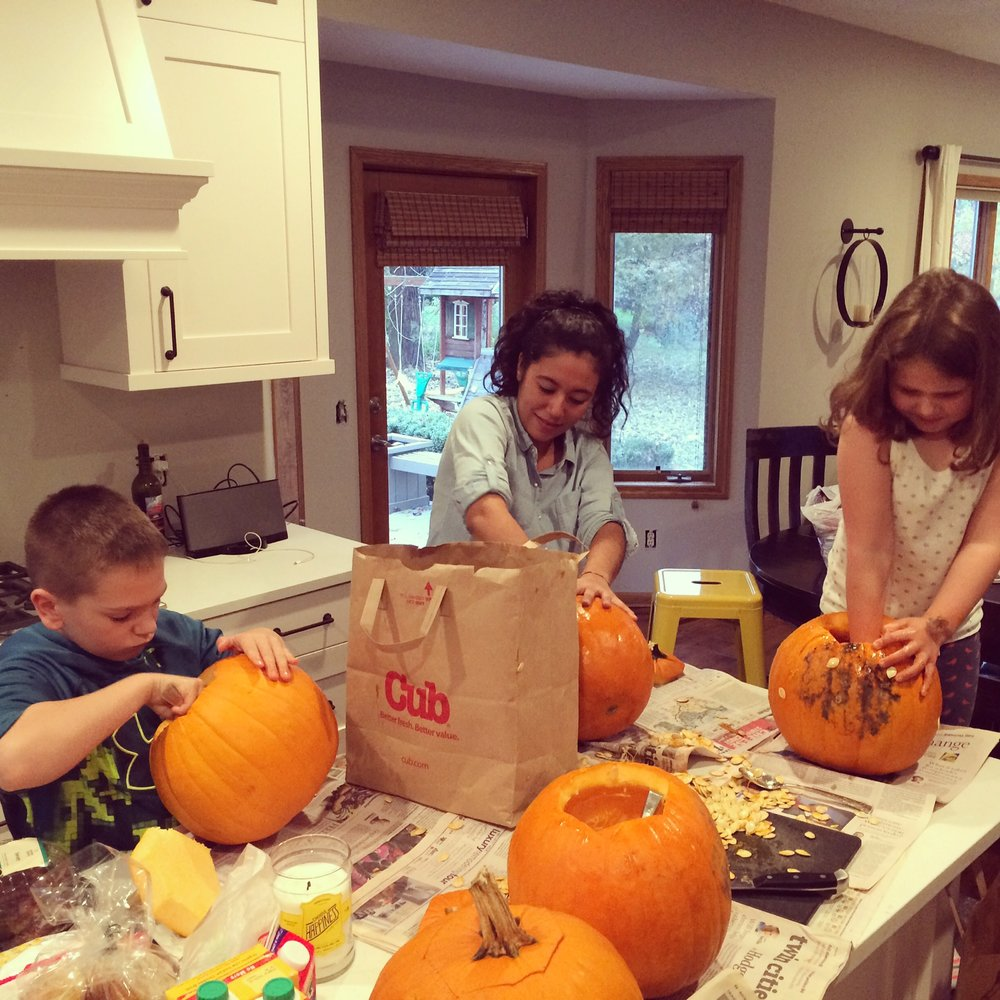 Melissa Cleaning out Pumpkins with the Hare Kids.JPG