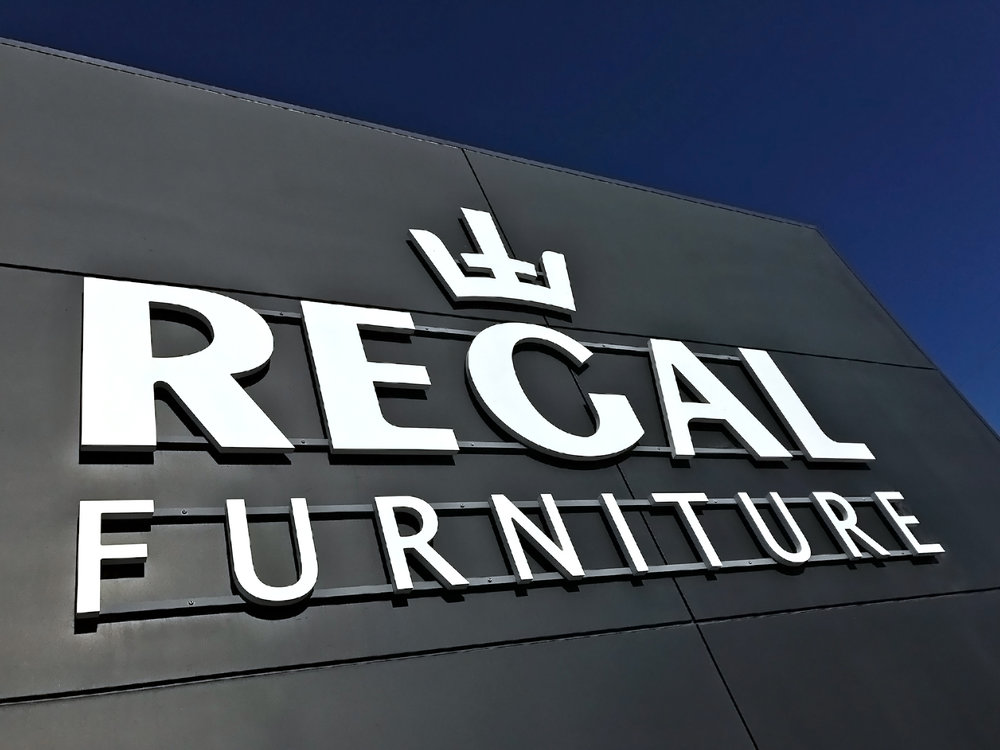 Regal Furniture signage with blue sky