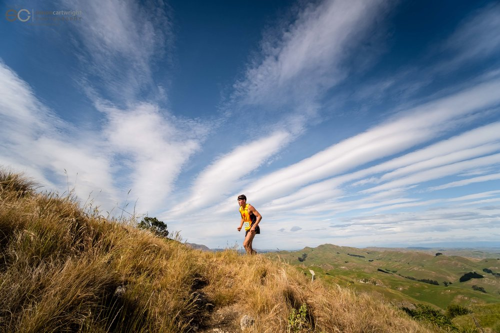 Peak Trail Blazer 2018 winner Niam Macdonald approaching the summit of Te Mata Peak.  Photo credit: Andrew Caldwell