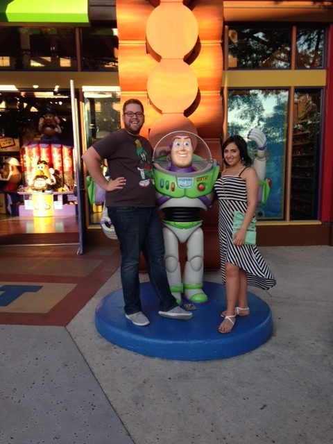 Richard and Sara posing with Buzz Lightyear in Downtown Disney.