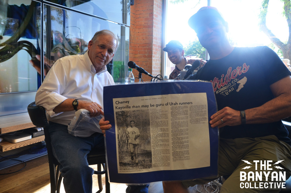 Jan Cheney and John Wojciechowski showing the old Standard Examiner article frequently referred to throughout the podcast. Photo bomb - Brandon Long.