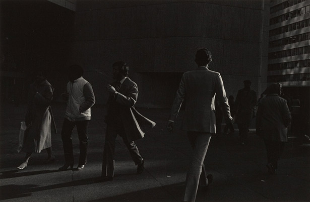 Images don't always have to utilise the full tonal range. Here Ray Metzker uses mostly shadow to mid-tones only. I find the deliberate concealment of the people's faces adds further mystery to the image. Image © Ray Metzker