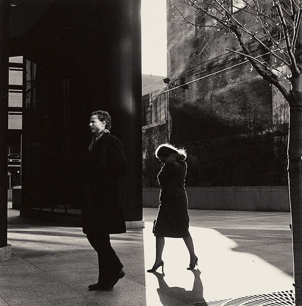 And sometimes it's the sudden split between shadow and sunlight that throws a contrast; like two images spliced together, providing a sense of tension between the two subjects in the frame. Image © Ray Metzker