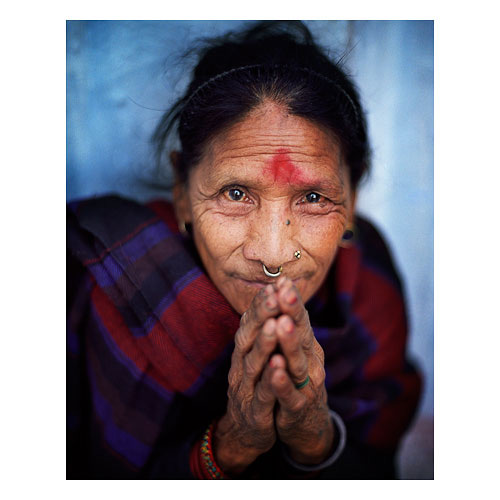 A woman I encountered many times at Boudha Stupa in Kathmandu in 2009, but it took me about six days to work up the courage to get in close and make this photo of her.