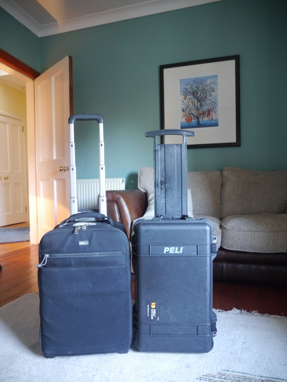 The Airport International Think Tank (Left) is wider than the Peli-Case. It allows me to carry more items but the Peli Case is more durable and still allows me to carry most of my items.