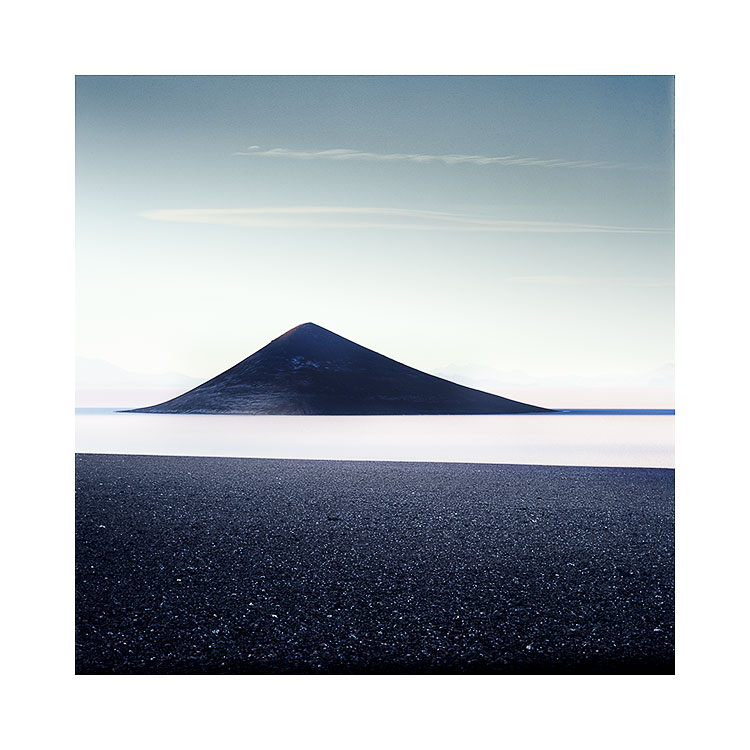 Image made in 2017, on my second visit. The sky was less blue, and the contrasts of the cone and black desert stood out more. I also choose to tighten the crop a bit to focus more on the conical shape of the volcano.