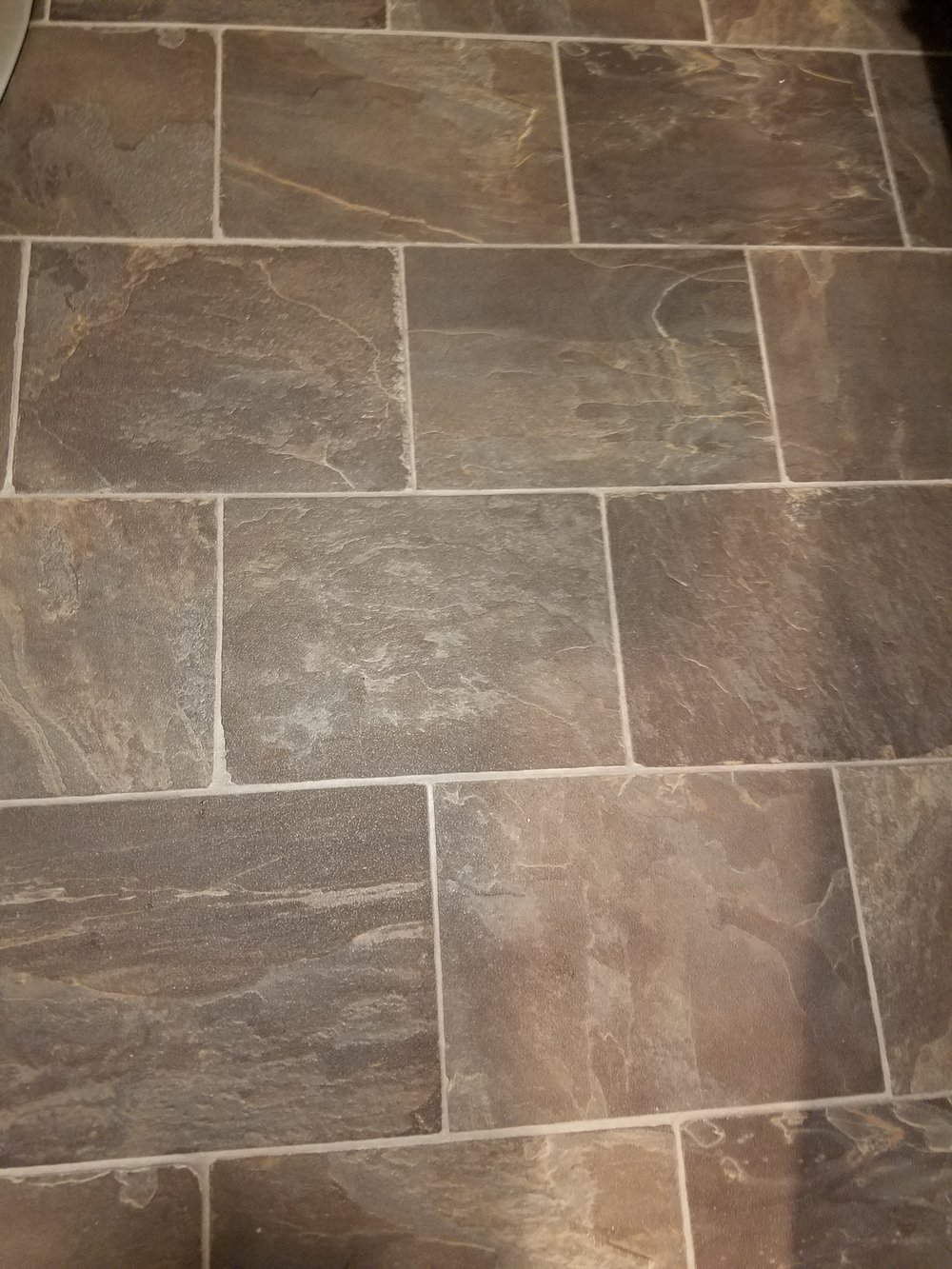 Vinyl flooring installed in a powder room