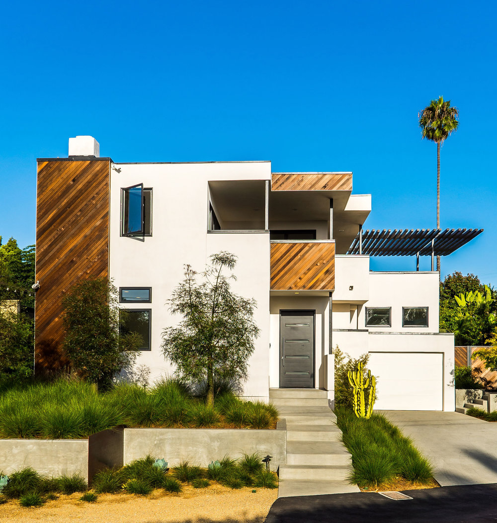 PC: Brett Hilton  The perfect curb appeal: softening the houses facade with textured grasses and colorful plant material.