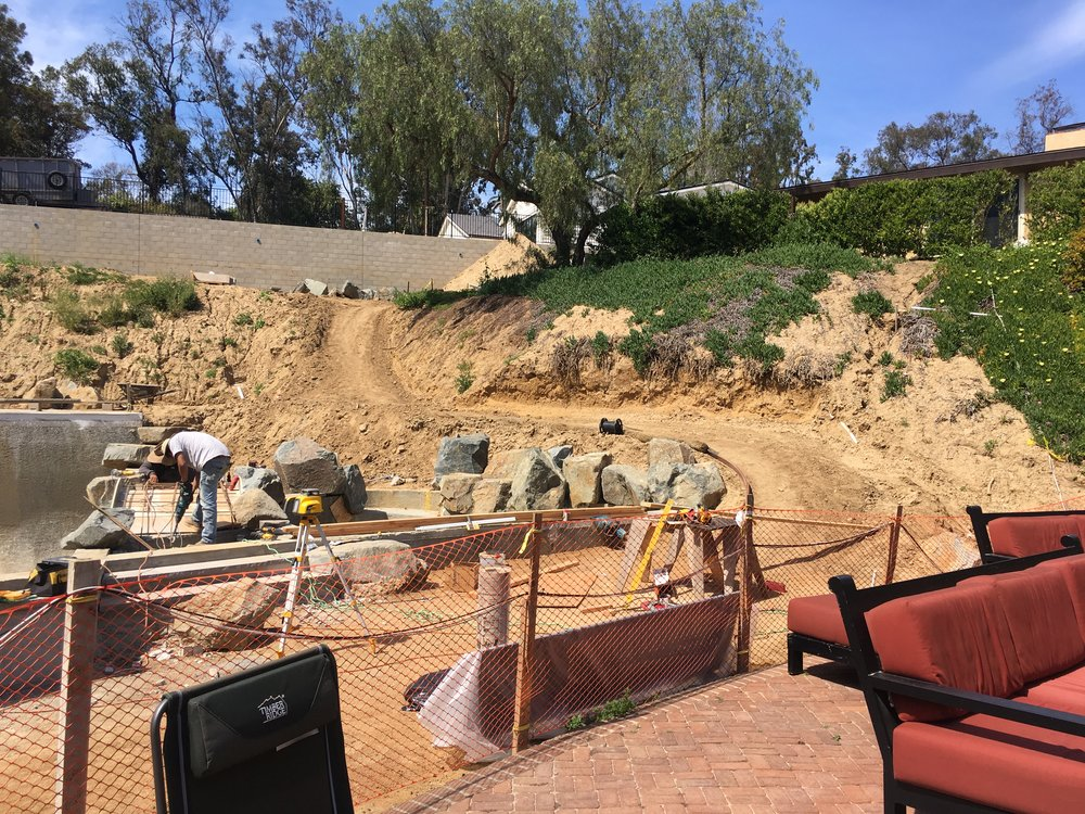 Digging out the hillside, now waiting for final details to be approved by the engineer and homeowner before we move on to the construction of the outdoor room.