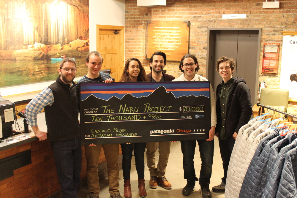 Naru Project collecting their (giant) grant check from the Patagonia team at the Lincoln Park store