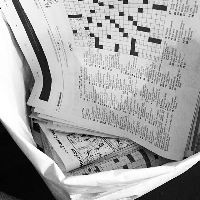 I know someone with a crossword hoarding problem. . . . #paper #holdingpaper #crossword #collector. #toofifteen #keeping5across #contained