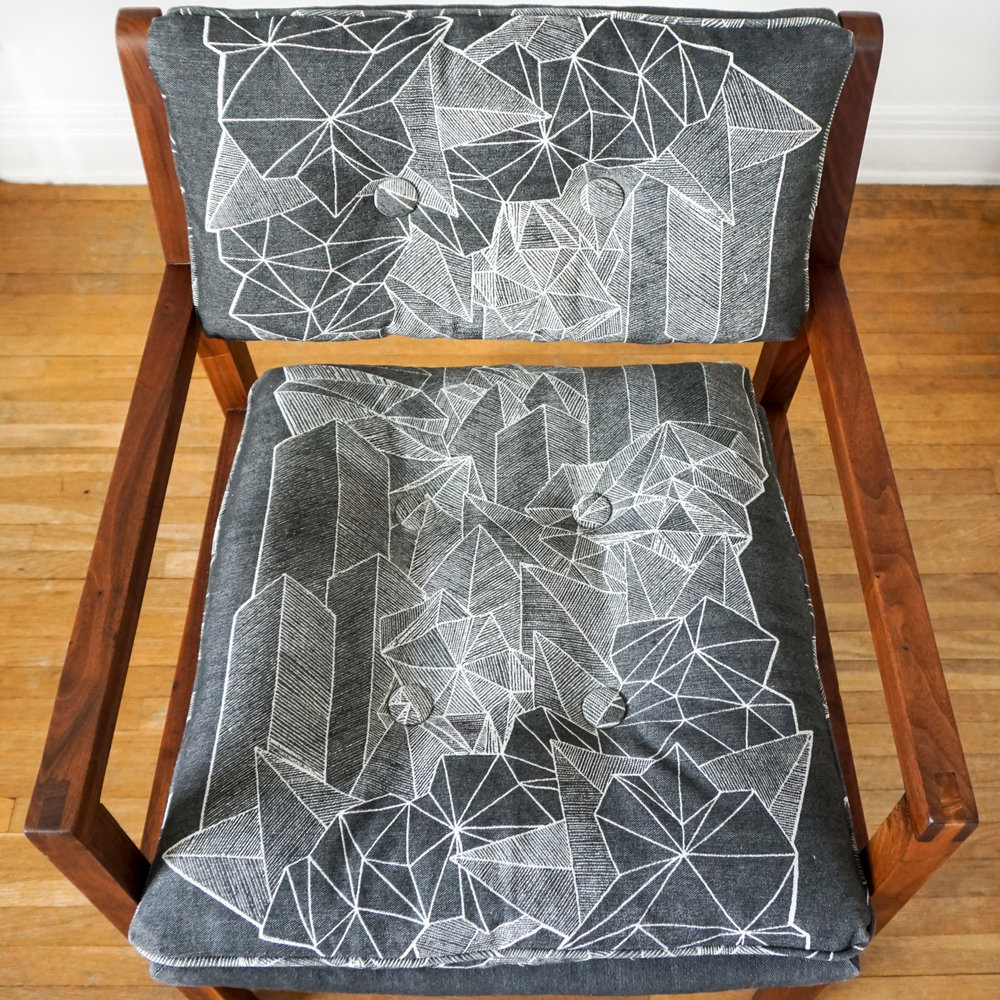 It takes six screen printed panels and careful planning to make this print dazzle from all angles.  Click through to get your own Downtown Sprawl Chair!