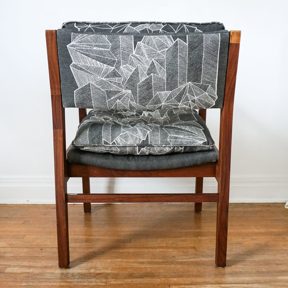No mistake how this print looks like from the back, the placement nicely frames the different shapes.  Click through to get your own  Downtown Sprawl Chair !