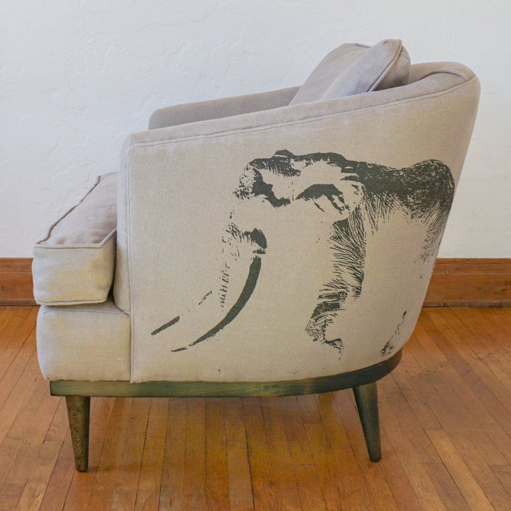Ghost of Satao flanks each side of this seat for a unique and classic style.