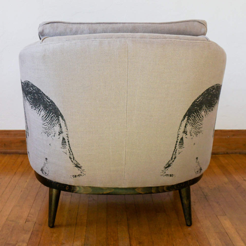 The paired print offers an interesting back view of the chair.