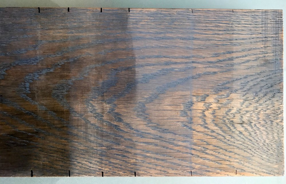 Two layers of different colored stain, in varying saturations.