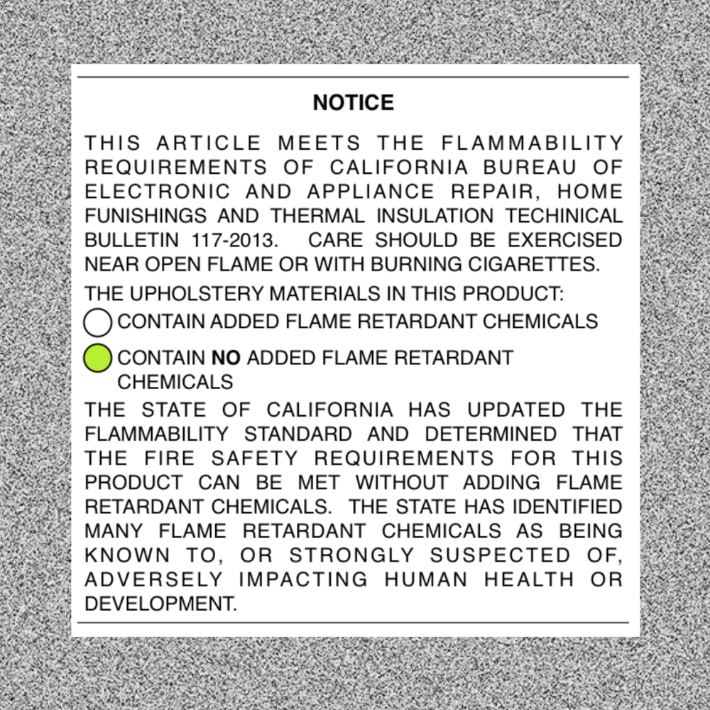 The white label indicates whether your furniture contains flame retardants.  CLICK THROUGH: Learn about TB117-2013.