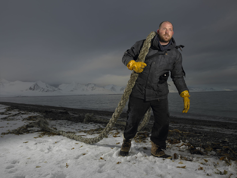 Outreach Campaign Team Manager for New Zealand, Christopher Burman, cleans up the beach in Poole Pynten, Svalbard. © Naomi Harris