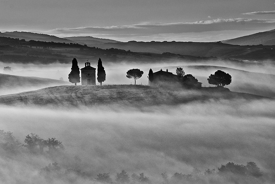 A chapel in early morning fog in Tuscany, Italy © Bob Krist