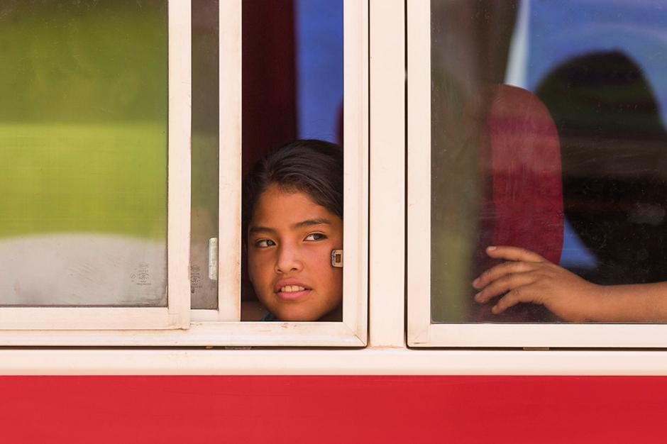 Girl on Bus, Bolivia © Eric Meola 2013