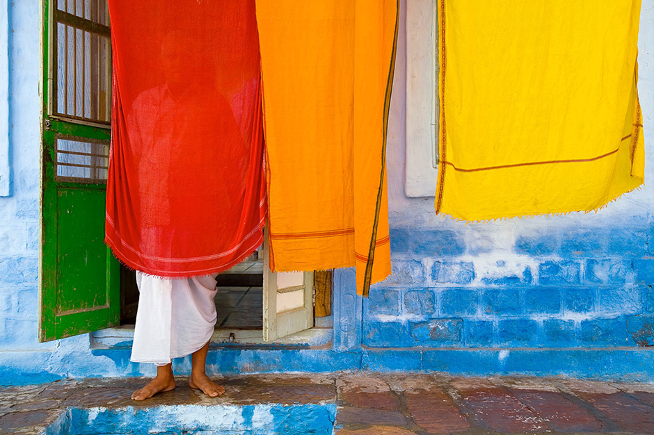 Priest with Laundry, India © Eric Meola 2007
