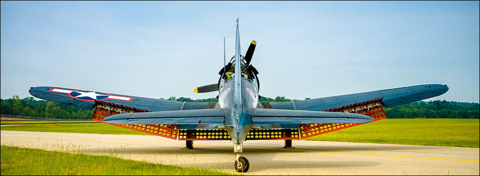 The SBD-5 Dive Bomber on the taxiway at Falcon Field, Peachtree City, Georgia. Owned and operated by the Dixie Wing of the Commemorative Air Force. © John Slemp