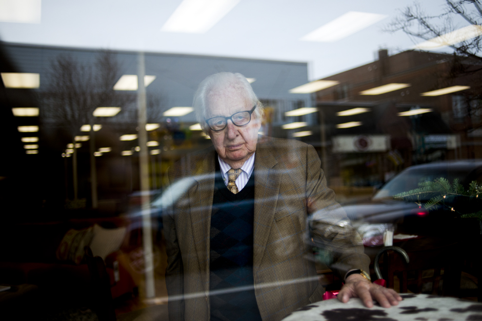 Tony Pomerleau, 95, stands in the window of Mill River Furniture in Newport at its grand opening on November 15, 2012. Pomerleau owns the building — which happens to be where he got his first job at age 14 in 1931 — trimming windows at JJ Newberry. Pomerleau continues to be an active business man, philanthropist, storyteller and dealmaker extraordinaire.© Maddie McGarvey