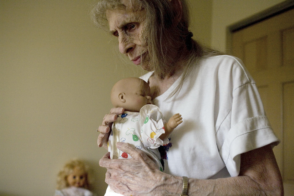 """Mona Jewel holds a doll in her apartment at Kimberly Meadows elderly home in Nelsonville, Ohio on April 30, 2010. Jewel never got married and never had kids. """"Everyone tells me I'm smart for not getting married and having kids. But I'm not. I wish I had a couple kids to keep me company and take care of me now. I'm all alone,"""" Jewel said.© Maddie McGarvey"""