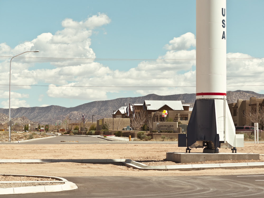 A nuclear missile stands opposite speculative housing in Albuquerque next to the Museum of Nuclear History. This missile was identical to the space rockets which were used to launch the first American astronauts in the Mercury program. © Paul Freeman