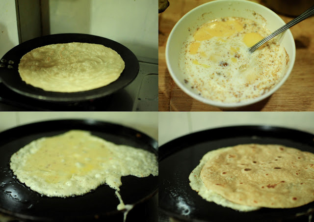 Pour the egg mix of egg, milk and spices on the tawa and make an omelet. As the omelet is cooking plaee the roti on the egg. The half cooked eggs omelet sticks to the roti. Cook on a low heat.