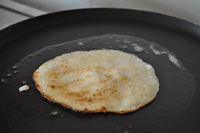 5. When the batter bubbles on the tawa and the edges seem to be browning up, flip the pancake.