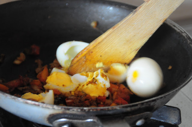 6.  With a wooden spoon- break the eggs. Be careful not to mash them too much.