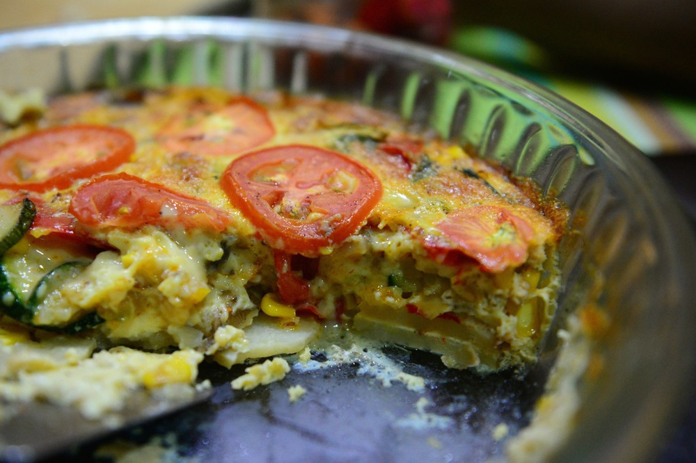 You can see the layers upon layers. Potatoes, veggies, corn, egg and tomatoes
