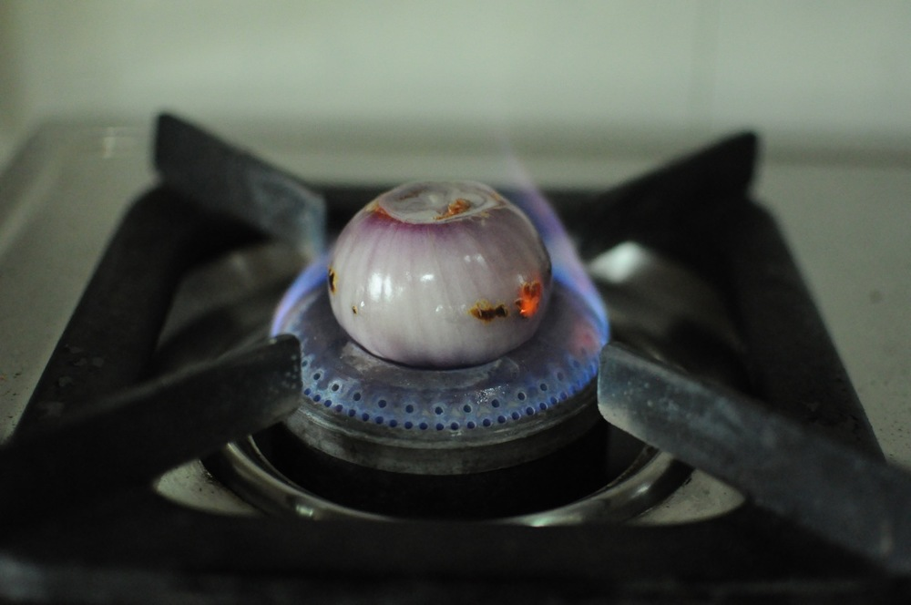 Char the onion on a low flame
