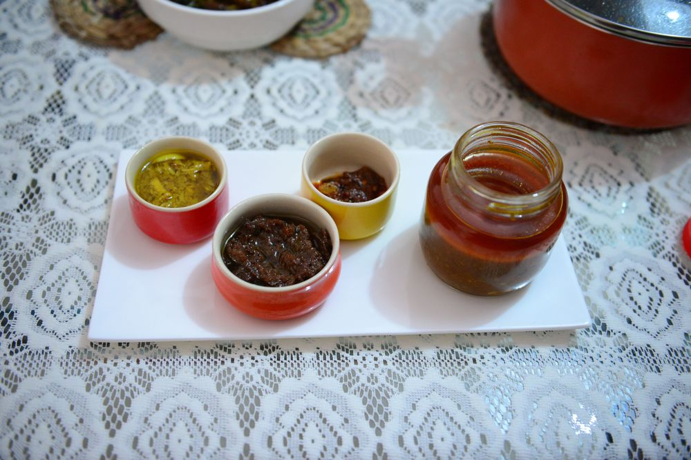 From L to R- Bamboo shoot chutney, Indian olives paste, Killer Naga chili, and the Pork Pickle