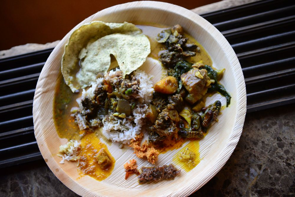 My plate of all the yummy curries, silkworms, pickles, sticky rice and dal
